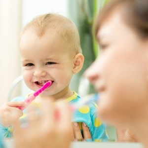 Helpful tips for brushing your baby's teeth. Some of my favorite baby care tips!