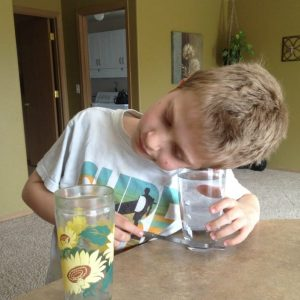 Easy homeschool science experiment. for kids. Find out if sounds are louder under water!
